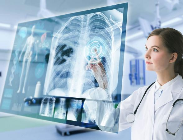 Doctor working on high-tech monitor screen